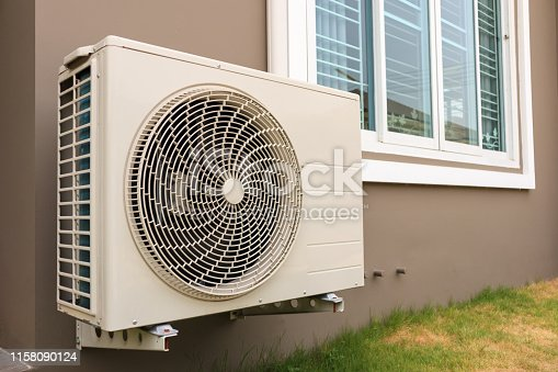 939450782 istock photo Air conditioner compressor outdoor unit installed outside the house 1158090124