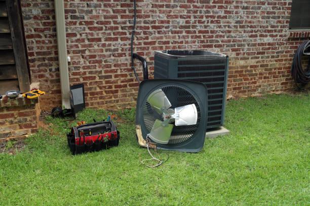 air conditioner condenser coil with tools being repaired - conduttura dell'aria foto e immagini stock