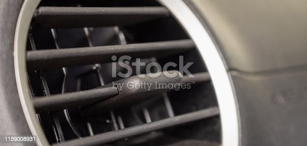 istock Air conditioner in modern compact car close up 1159008931