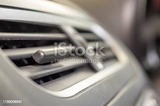 istock Air conditioner in modern compact car close up 1159008932