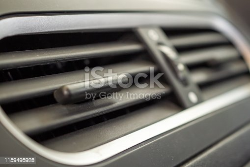 istock Air conditioner in modern compact car close up 1159495928