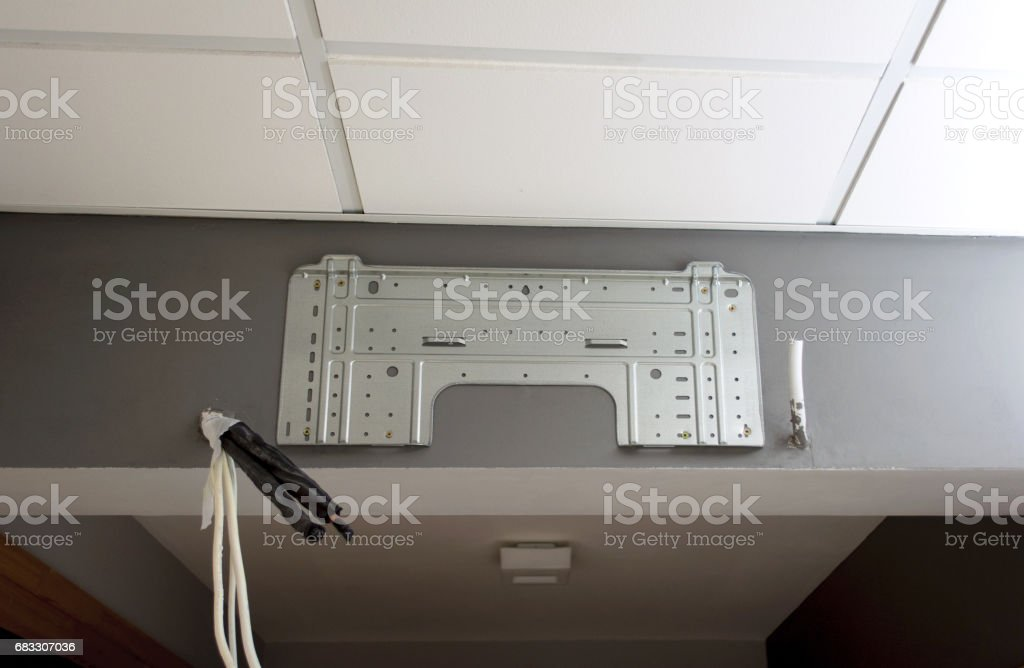 Air conditioner installation on a office or home wall foto stock royalty-free