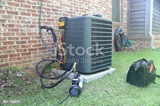 Air Conditioner Maintenance with gauges and vacuum pump