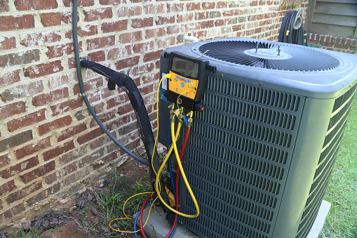 istock Air Conditioner Maintenance 997801708
