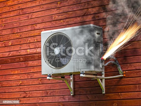 istock Air conditioner on fire 489862656
