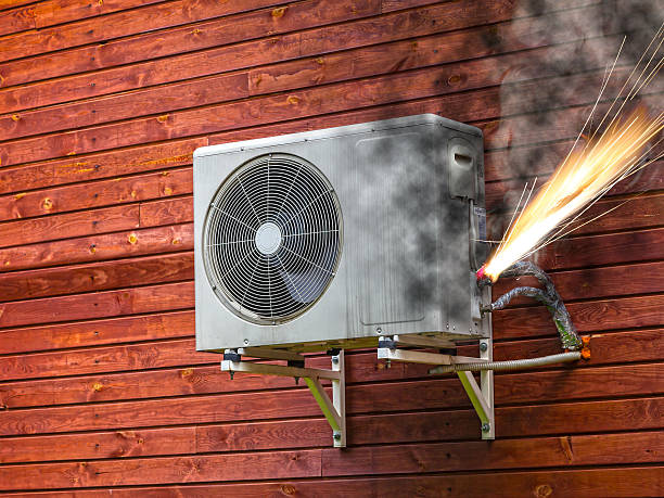 Air conditioner on fire stock photo