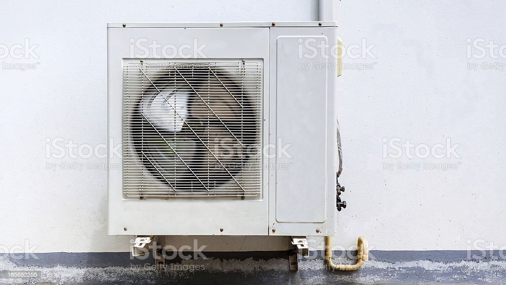 Air conditioner on wall house stock photo