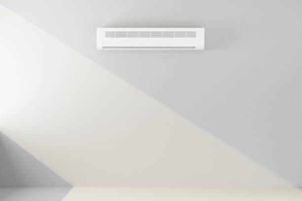 air conditioner on white wall stock photo