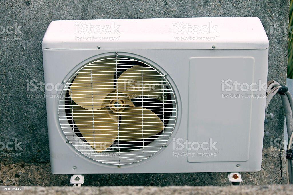 air conditioner outside compressor and condenser unit stock photo