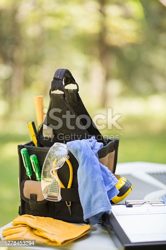 istock Air conditioner service call. 1278453294