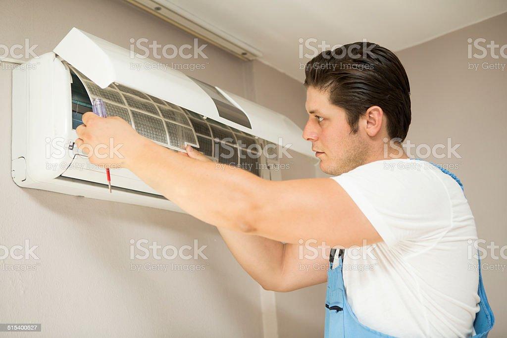 Air conditioner technician stock photo