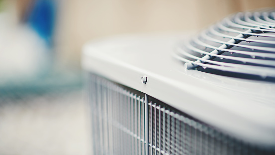 istock Air conditioner unit in residential garden 966007226