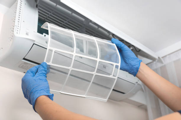 Air conditioner unit service Modern air conditioner unit service. Cleaning the filter, fumigation. Air conditioner service. air filter stock pictures, royalty-free photos & images