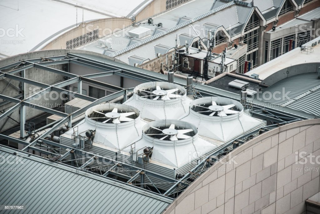 Air Conditioner ventilation system on building rooftop stock photo