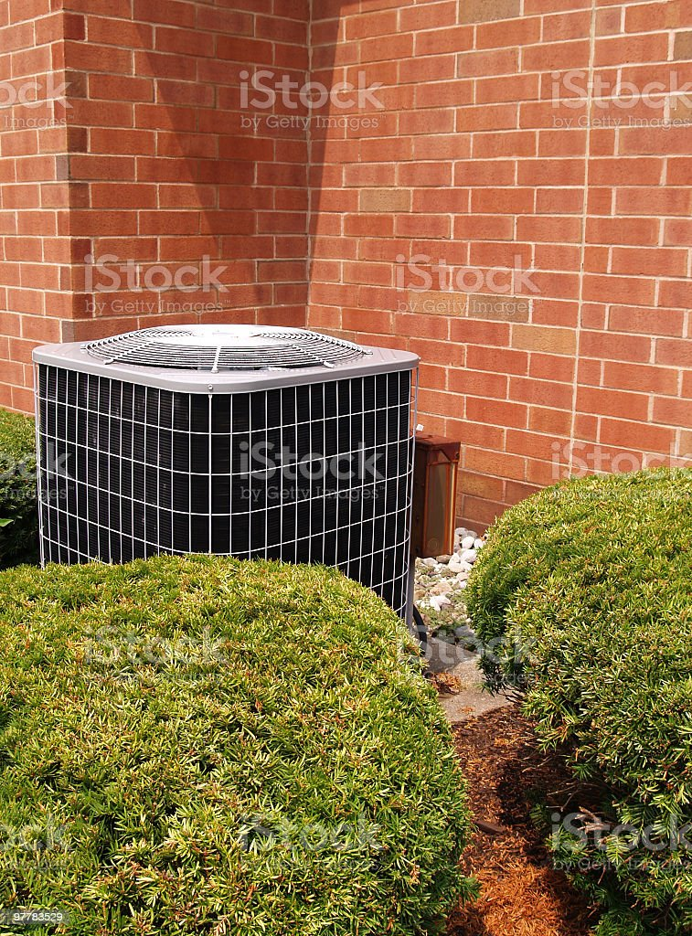 Air conditioner with brick building in background royalty-free stock photo