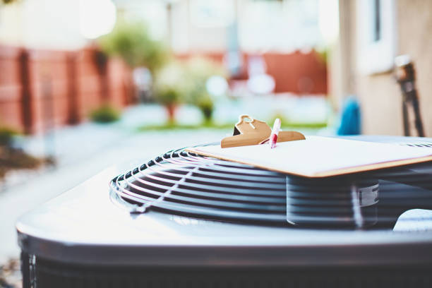 Air conditioner with clipboard and paper stock photo