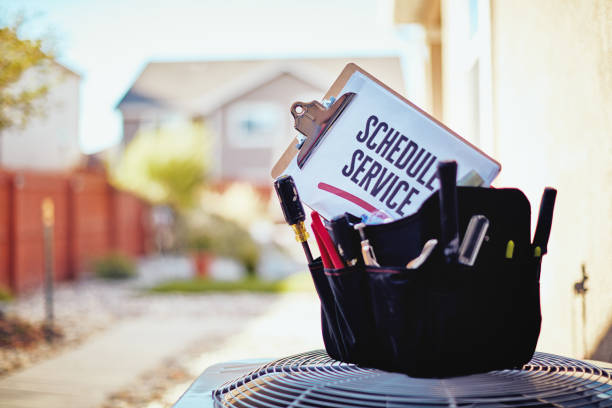 air conditioner with maintenance tools and service reminder in residential back yard - repairing stock photos and pictures