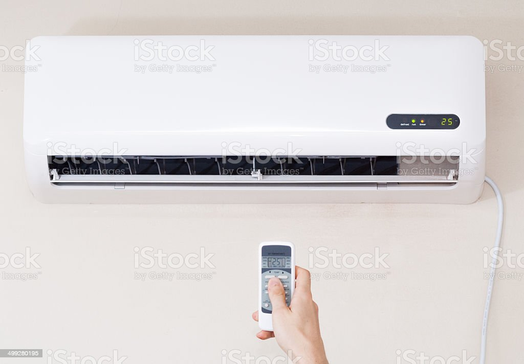 air conditioner with remote controller stock photo