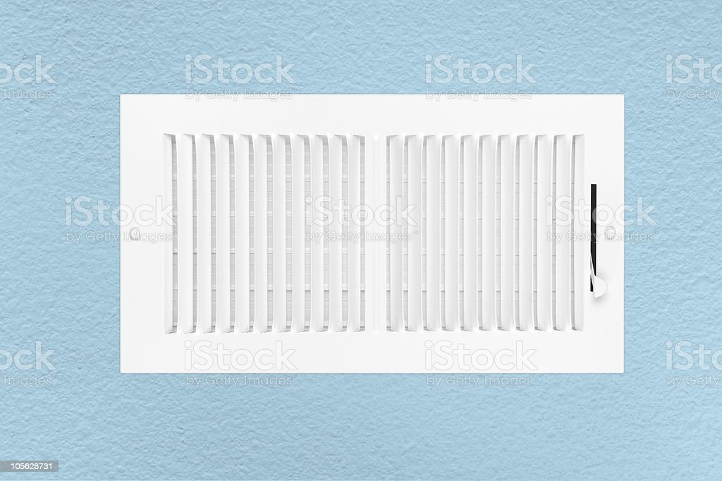 Air conditioning and heating vent on wall stock photo