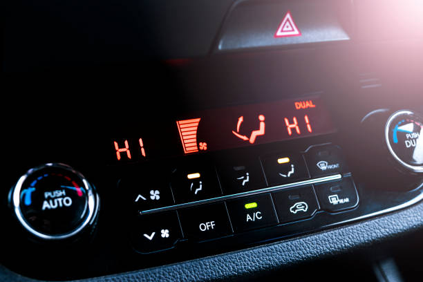 Air conditioning button inside a car. Climate control AC unit in the new car. Modern car interior details stock photo