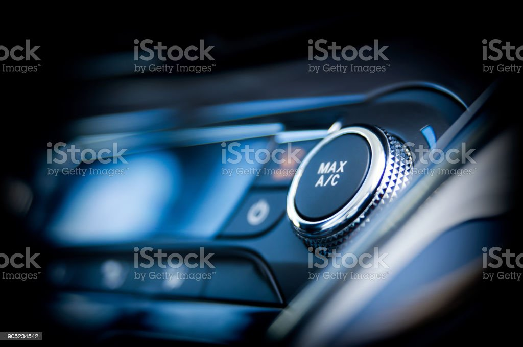 Air conditioning button inside a car stock photo