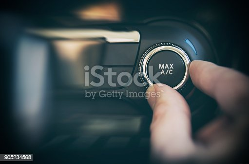 istock Air conditioning button inside a car 905234568