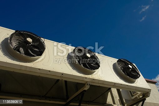 istock Air conditioning compressor installed on the building 1135390512