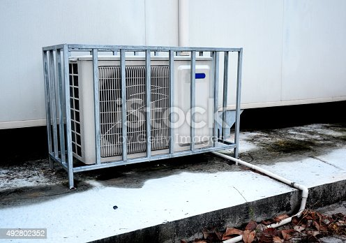 istock Air conditioning compressor outside building 492802352