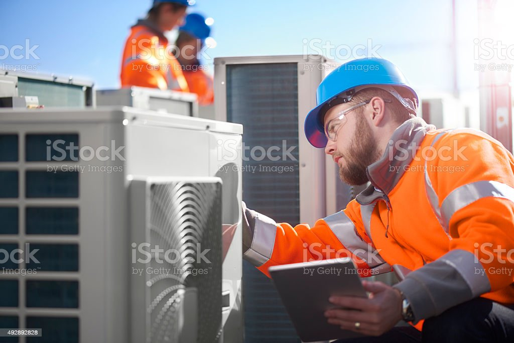 air conditioning engineer stock photo
