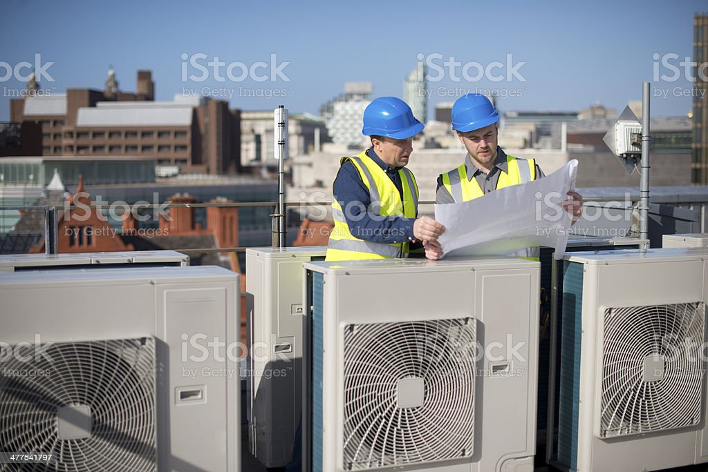 air conditioning engineers stock photo