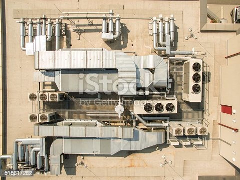 Air conditioning equipment atop a modern building - aerial drone view of the roof with all the necessary installations