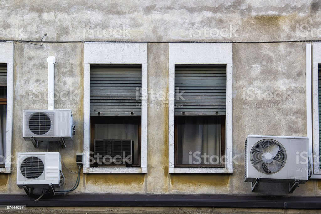 Air Conditioning Equipment outside of an Hold House stock photo