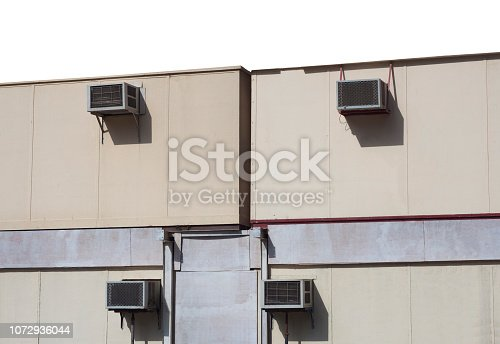 1132460292 istock photo air conditioning equipments on exterior building 1072936044