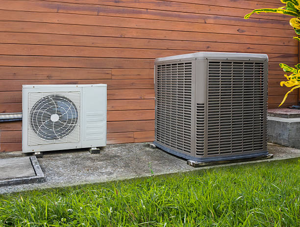 air conditioning heat pumps - heat stock photos and pictures