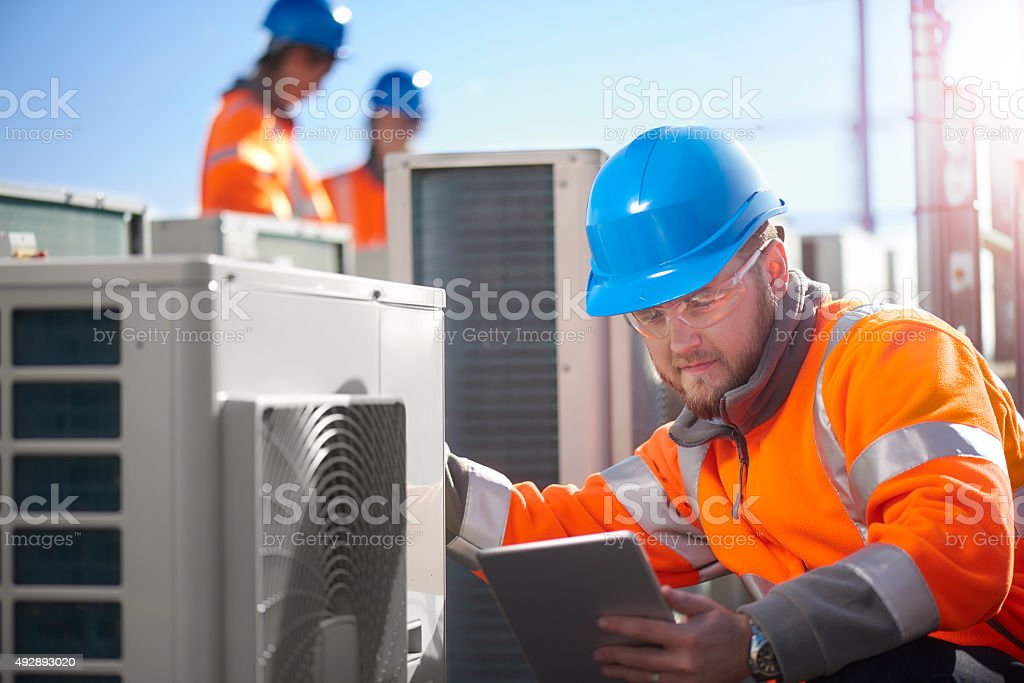 air conditioning installation on rooftop stock photo