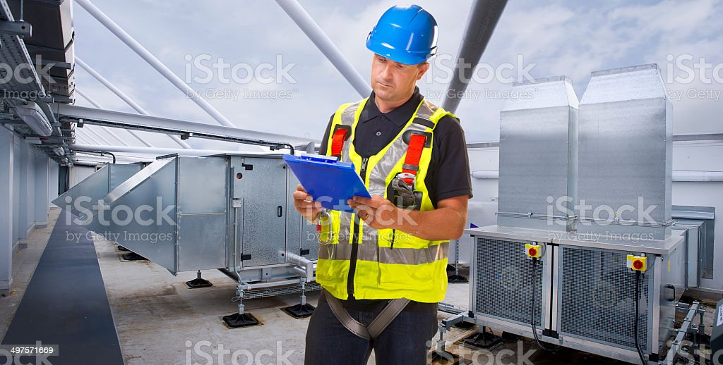 air conditioning installation on rooftop royalty-free stock photo