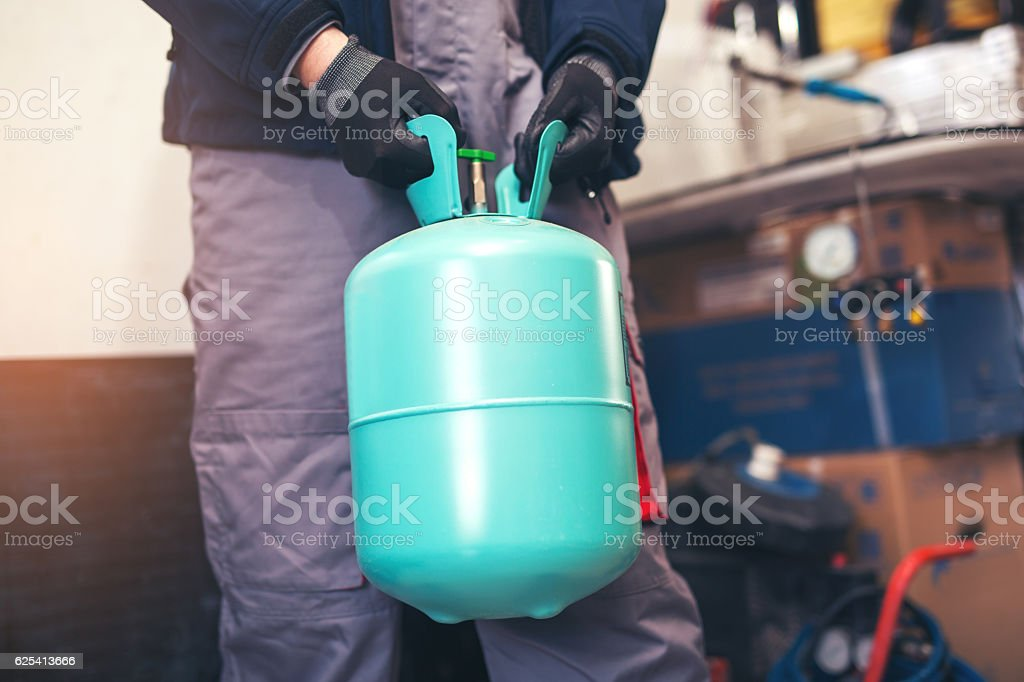 Air conditioning master preparing to install new air conditioner stock photo
