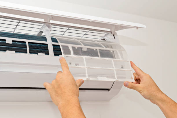 Air conditioning on a white wall stock photo