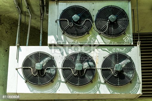 939450782 istock photo Air conditioning outdoor units on the building facade. 811393608