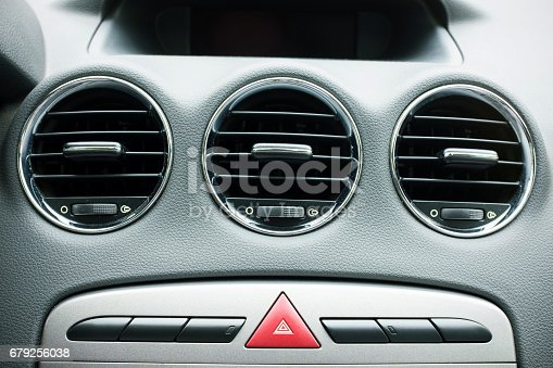 695724912istockphoto Air conditioning system in a modern car 679256038
