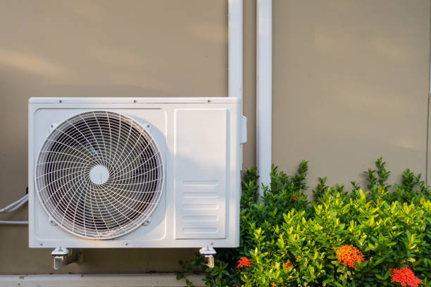 Air conditioning system installation embedded on wall of building stock photo