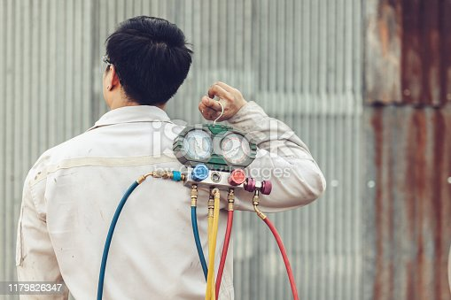 962280084 istock photo Air Conditioning Technician and A part of preparing to install new air conditioner. 1179826347