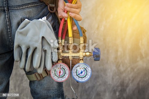 istock Air Conditioning Technician and A part of preparing to install new air conditioner. 861672258