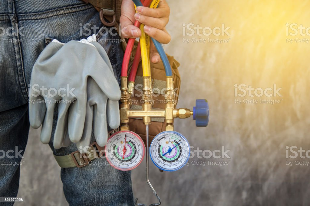 Air Conditioning Technician and A part of preparing to install new air conditioner. stock photo
