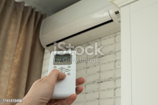 istock air conditioning, temperature control with remote control, cooling. 1141415456