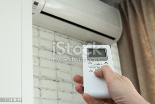 istock air conditioning, temperature control with remote control, cooling. 1141415476