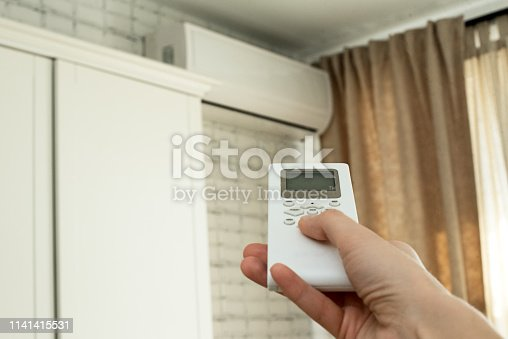 istock air conditioning, temperature control with remote control, cooling. 1141415531