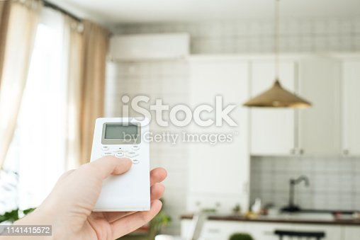 istock air conditioning, temperature control with remote control, cooling. 1141415572