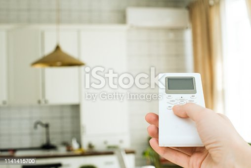 istock air conditioning, temperature control with remote control, cooling. 1141415700