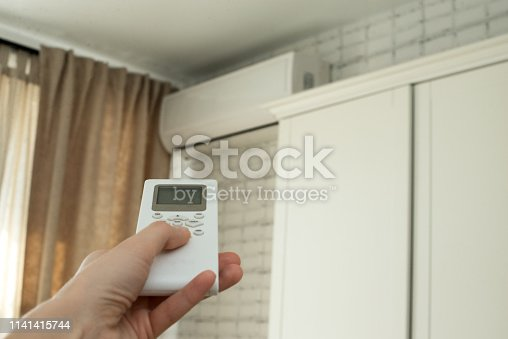 istock air conditioning, temperature control with remote control, cooling. 1141415744